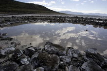 The clouds are reflected in the Spiral Jetty along the northern portion of the Great Salt Lake in 2009. Tribune file photo