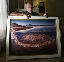 Steve Griffin  |  The Salt Lake Tribune    Bob Phillips holds a giant photograph, taken by photographer Gianfranco Gorgoni, of the Spiral Jetty.  Phillips was the contractor who built the Spiral Jetty for artist Robert Smithson.