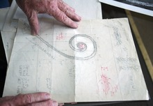 Steve Griffin  |  The Salt Lake Tribune   Bob Phillips looks over the original drawings for the Spiral Jetty  in his Ogden home on Thursday, Feb. 24, 2011.  Phillips was the contractor who built the Spiral Jetty for artist Robert Smithson.
