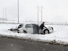 Mark Havnes  |  The Salt Lake Tribune  State tropper Kim Riddle's car is seen on the side of I-15 in Cedar City after another car hit her due to icy conditions Monday. Nobody in either car was seriously injured.