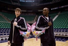 Djamila Grossman  |  The Salt Lake Tribune  Utah Jazz rookies Gordon Hayward and Jeremy Evans hold their rookie backpacks at Energy Solutions Arena in Salt Lake City, Thursday, Feb. 3, 2010.