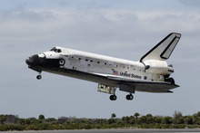 Space shuttle Discovery lands at the Kennedy Space Center in Cape Canaveral, Fla., Wednesday, March 9, 2011. (AP Photo/John Raoux)
