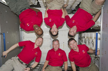 In this March 4, 2011 photo provided by NASA, inside the newly installed Permanent Multipurpose Module (PMM) on the International Space Station are the six crew members of the STS-133 crew who've been spending busy days with the six astronauts and cosmonauts of Expedition 26, not shown. At bottom, from the left, are astronauts Eric Boe, Steve Lindsay and Michael Barratt. On top are astronauts Alvin Drew, Nicole Stott and Steve Bowen (AP Photo/NASA)