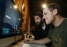 Scott Sommerdorf  l  The Salt Lake Tribune Sean Forsgren, left, and Brandon Davies look over the features of a ame called