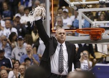 Trent Nelson  |  The Salt Lake Tribune BYU coach Dave Rose cuts a piece of the net in celebration after BYU defeated Wyoming, college basketball in Provo, Utah, Saturday, March 5, 2011.