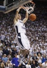 Trent Nelson  |  The Salt Lake Tribune BYU's Jackson Emery dunks the ball as BYU hosts Wyoming, college basketball in Provo, Utah, Saturday, March 5, 2011.
