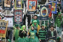 Parade revelers from Squatters Pub  march in a past St Patrick's parade. Tribune file photo