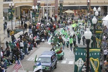An enthusiastic  crowd  joins in the fun of a past St. Patrick's parade in Salt Lake City. Tribune file photo