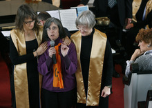 Scott Sommerdorf  |  The Salt Lake Tribune Joan Gregory (center), is supported by choir members Krista Bowers (left) and Judy Lord as she speaks to the congregation about the Tim DeChristopher trial. The Unitarian Universalist Church in Salt Lake City showed it's support for Tim DeChristopher during it's service, Sunday, March 6, 2011.