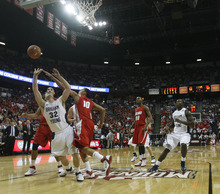 Rick Egan  | Salt Lake Tribune  BYU guard Jimmer Fredette (32) shoots for the Cougars, as  m10 defends, in the Mountain West Conference Championships, BYU vs. New Mexico,  in Las Vegas, Friday, March 11, 2011.  Fredette had 52 points for the Cougars in their 87-76 win over the Lobos.