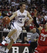 Rick Egan  | Salt Lake Tribune  BYU guard Jackson Emery (4) passes the ball off, in the Mountain West Conference Championships, BYU vs. New Mexico,  in Las Vegas, Friday, March 11, 2011.  Fredette had 33 points for the Cougars in the first half.