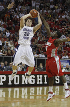 Rick Egan  | Salt Lake Tribune  BYU guard Jimmer Fredette (32) shoots for the Cougars, as New Mexico guard Curtis Dennis (3) defends, in the Mountain West Conference Championships, BYU vs. New Mexico,  in Las Vegas, Friday, March 11, 2011.  Fredette had 52 points for the Cougars in their 87-76 win over the Lobos.