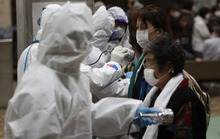 Evacuees are screened for radiation contamination at a testing center Tuesday, March 15, 2011, in Koriyama city, Fukushima Prefecture, northern Japan, four days after a massive earthquake and tsunami struck the country's north east coast. (AP Photo/Wally Santana)