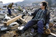 For many in Japan, little is left but wreckage and fear of radiation. (AP photo)