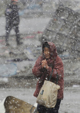 In the wake of an earthquake, tsunami and nuclear plant disasters, Japanese also suffering from cold weather. (AP photo)