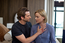 In this film publicity image released by Relativity Media, Bradley Cooper, left, and Abbie Cornish are shown in a scene from