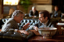 In this film publicity image released by Relativity Media, Robert De Niro, left, and Bradley Cooper are shown in a scene from