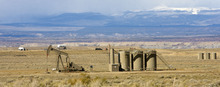 Al Hartmann  |  Salt Lake Tribune Gas wells work south of Myton and U.S. Highway 40 on the edge of the Book Cliffs western expanse. Mountains to the North are the Uintah Range.