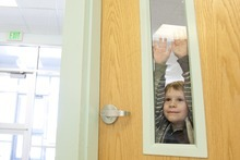 Kina Wilde  |  Special to The Salt Lake Tribune  Karson Reese, 4, watches out the window as his mother Brandee approaches to pick him up from South Preschool in Cedar City on Tuesday, March 15, 2011.
