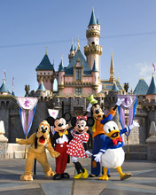 The classic Disney characters welcome visitors outside Sleeping Beauty Castle at Disneyland in Anaheim, Calif. From left, Pluto, Mickey Mouse, Minnie Mouse, Goofy and Donald Duck (Scott Brinegar/Disneyland)