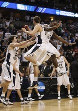 Trent Nelson  |  The Salt Lake Tribune BYU's Jimmer Fredette, Kyle Collinsworth and Charles Abouo celebrate as BYU defeats Gonzaga in the NCAA Tournament, men's college basketball at the Pepsi Center in Denver, Colorado, Saturday, March 19, 2011, earning a trip to the Sweet 16.