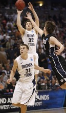 Trent Nelson  |  The Salt Lake Tribune BYU's Jimmer Fredette puts up a shot with Gonzaga's Kelly Olynyk defending, as BYU faces Gonzaga in the NCAA Tournament, men's college basketball at the Pepsi Center in Denver, Colorado, Saturday, March 19, 2011. At bottom is BYU's Kyle Collinsworth.