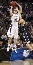 Trent Nelson  |  The Salt Lake Tribune BYU's Jimmer Fredette shoots over Gonzaga's Mike Hart as BYU faces Gonzaga in the NCAA Tournament, men's college basketball at the Pepsi Center in Denver, Colorado, Saturday, March 19, 2011.