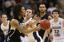 Trent Nelson  |  The Salt Lake Tribune BYU's Jackson Emery defending Gonzaga's Steven Gray as BYU faces Gonzaga in the NCAA Tournament, men's college basketball at the Pepsi Center in Denver, Colorado, Saturday, March 19, 2011.