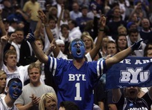 Trent Nelson  |  The Salt Lake Tribune BYU fans celebrate as BYU defeats Gonzaga in the NCAA Tournament, men's college basketball at the Pepsi Center in Denver, Colorado, Saturday, March 19, 2011, earning a trip to the Sweet 16.
