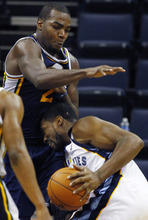 Utah Jazz's Paul Millsap, right, defends against Memphis Grizzlies' Loen Powe, left, during the second half of an NBA basketball game in Memphis, Tenn., Monday, March 21, 2011. (AP Photo/Mark Weber)