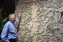 Trent Nelson  |  The Salt Lake Tribune Ronald Lowe explains details in a replica of Izapa Stela 5, or