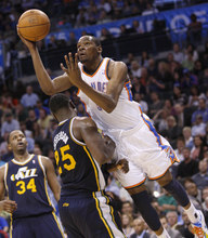 Oklahoma City Thunder forward Kevin Durant, right, collides with Utah Jazz forward Al Jefferson during the fourth quarter of an NBA basketball game in Oklahoma City, Wednesday, March 23, 2011. Oklahoma City won 106-94. (AP Photo/Sue Ogrocki)