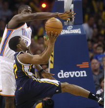 Oklahoma City Thunder center Nazr Mohammed blocks a shot by Utah Jazz guard Ronnie Price during the fourth quarter of an NBA basketball game in Oklahoma City, Wednesday, March 23, 2011. Oklahoma City won 106-94. (AP Photo/Sue Ogrocki)