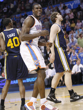 Oklahoma City Thunder forward Serge Ibaka, center, reacts after missing a shot against the Utah Jazz in the fourth quarter of an NBA basketball game in Oklahoma City, Wednesday, March 23, 2011. Jazz forward Jeremy Evans is at left, and center Kyrylo Fesenko, of Ukraine, is at right. Oklahoma City won 106-94. (AP Photo/Sue Ogrocki)