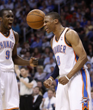 Oklahoma City Thunder guard Russell Westbrook, right, and forward Serge Ibaka react after Westbrook scored against the Utah Jazz in the fourth quarter of an NBA basketball game in Oklahoma City, Wednesday, March 23, 2011. Oklahoma City won 106-94. (AP Photo/Sue Ogrocki)
