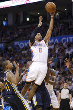 Oklahoma City Thunder guard Russell Westbrook shoots in front of Utah Jazz guard Earl Watson, left, in the third quarter of an NBA basketball game in Oklahoma City, Wednesday, March 23, 2011. Oklahoma City won 106-94. (AP Photo/Sue Ogrocki)