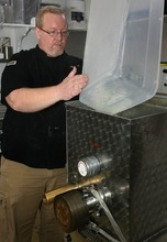 Leah Hogsten  |  The Salt Lake Tribune Kyle Lore pours the mixture of hard red wheat and semolina flours into his pasta extruder during a recent demonstration.