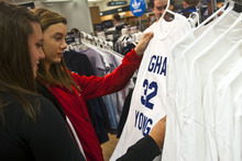 Chris Detrick | The Salt Lake Tribune  Jessie Wengert and Jordan Wengert, both of Marana, Ariz., look at Jimmer Fredette basketball jerseys for sale at the BYU Bookstore on Wednesday March 23, 2011. In the home of the Cougars, merchandise is flying off shelves.