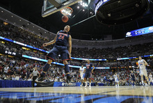 Arizona's Brendon Lavender (24) finishes a dunk against Duke during the second half of a West regional semifinal game in the NCAA college basketball tournament, Thursday, March 24, 2011, in Anaheim, Calif. Arizona defeated Duke 93-77.  (AP Photo/Mark J. Terrill)