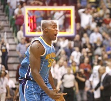Paul Fraughton  |  The Salt Lake Tribune New Orleans Hornets center Emeka Okafor (50) celebrates his buzzer beater shot to send the game into overtime. The Utah Jazz played the New Orleans Hornets at EnergySolutions Arena on Thursday  March 24, 2011.