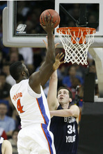 Scott Sommerdorf  |  The Salt Lake Tribune BYU forward Noah Hartsock tries to defend against Florida forward/center Patric Young during second half play. BYU lost 83-74 in OT to Florida at the New Orleans Arena in their first round game of the