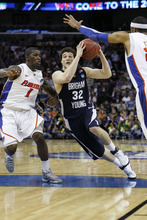 Scott Sommerdorf  |  The Salt Lake Tribune BYU guard Jimmer Fredette drives against Florida guard Kenny Boynton during second half play. BYU lost 83-74 in OT to Florida at the New Orleans Arena in their first round game of the