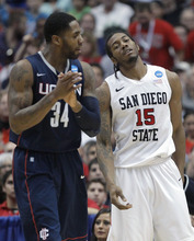 San Diego State's Kawhi Leonard (15) reacts after being for a foul as Connecticut's Alex Oriakhi (34) applauds during the second half of a West regional semifinal in the NCAA college basketball tournament Thursday, March 24, 2011, in Anaheim, Calif.  (AP Photo/Jae C. Hong)