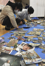Even as hope for the missing has dwindled, the search for loved ones continues in earthquake, tsunami and nuclear plant disaster stricken Japan. (AP photo)
