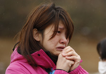 The search for the missing in Japan has more and more become a quest for their remains; then comes the grief. (AP photos)