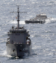 U.S. Navy's barge YOGN-115, back, is towed by Japan's Maritime Self-Defense Force's multi purpose support ship off the coast of Isumi, Chiba Prefecture, Japan, Saturday, March 26, 2011. The barge carrying 1.04 million liters (275,000 gallons) of fresh water departed Commander, Fleet Activities Yokosuka (CFAY) Friday to support cooling efforts at the tsunami-damaged Fukushima Dai-ichi nuclear power plant. (AP Photo/Yomiuri Shimbun, Yasushi Kanno) JAPAN OUT, MANDATORY CREDIT