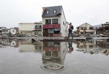 Rain falls in the March 11 earthquake and tsunami-destroyed city of Ofunato, northern Japan Saturday, March 26, 2011. (AP Photo/Yomiuri Shimbun, Hiroto Nomoto) JAPAN OUT, MANDATORY CREDIT