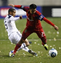 Djamila Grossman     The Salt Lake Tribune  Real Salt Lake's Paulo Araujo, Jr., (23) defends the ball against Los Angeles Galaxy's Sean Franklin (5) during the first half of a game at Rio Tinto Stadium in Sandy, Utah, on Saturday,  March 26, 2011. RSL won the game.