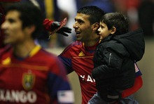 Djamila Grossman     The Salt Lake Tribune  Real Salt Lake's Javier Morales (11) greets fans as he carries his son, Santi, after RSL's win against Los Angeles Galaxy at Rio Tinto Stadium in Sandy, Utah, on Saturday,  March 26, 2011.