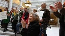 LEAH HOGSTEN  |  The Salt Lake Tribune Elise Lazar joined about 50 people gathered in the Capitol Rotunda to cheer on the repeal of HB477 on Friday. Lazar says the public has been awakened and won't go back to its previous apathy.